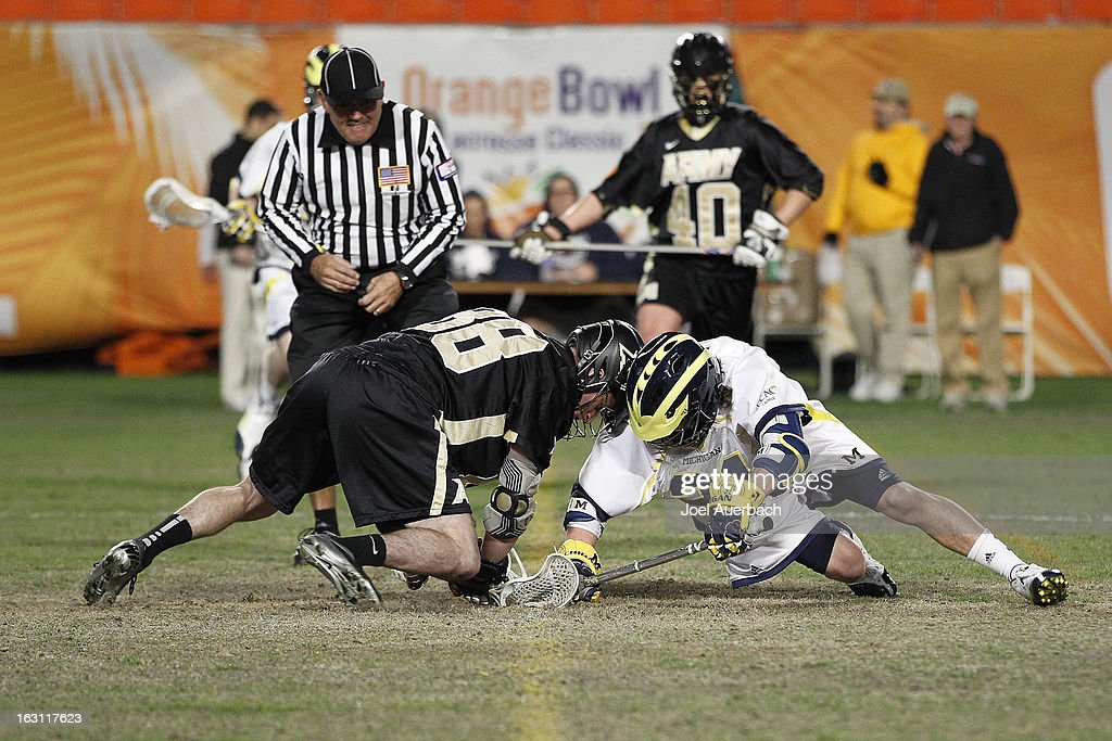 Alex Daly #88 of the Army Black Knights and Brad Lott #21 of the Michigan Wolverines battle for control of the ball during the 2013 Orange Bowl Lacrosse Classic on March 2, 2013 at SunLife Stadium in Miami Gardens, Florida. Army defeated Michigan 12-1.