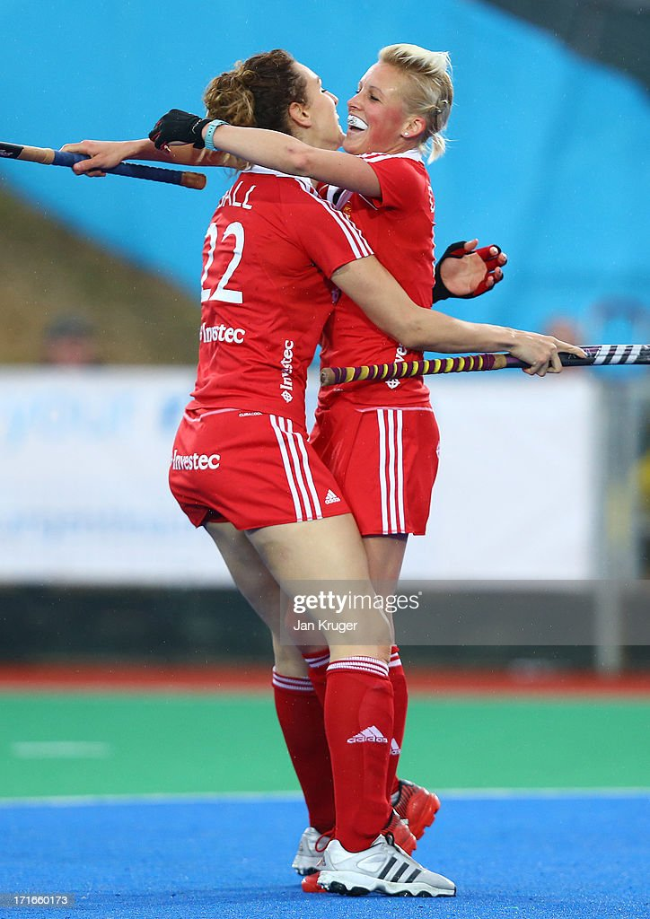 <a gi-track='captionPersonalityLinkClicked' href=/galleries/search?phrase=Alex+Danson&family=editorial&specificpeople=3415241 ng-click='$event.stopPropagation()'>Alex Danson</a> of England celebrates her goal with team mate <a gi-track='captionPersonalityLinkClicked' href=/galleries/search?phrase=Ashleigh+Ball+-+Field+Hockey+Player&family=editorial&specificpeople=15273009 ng-click='$event.stopPropagation()'>Ashleigh Ball</a> during the Investec Hockey World League quarterfinal match between England and Italy at the Quintin Hogg Memorial Sports Grounds on June 27, 2013 in London, England.