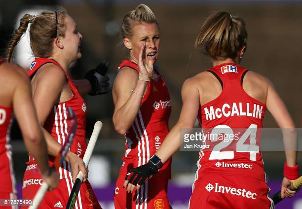 Alex Danson of England celebrates scoring her a goal with her team mates during the Quarter Final match between England and India during the FIH...