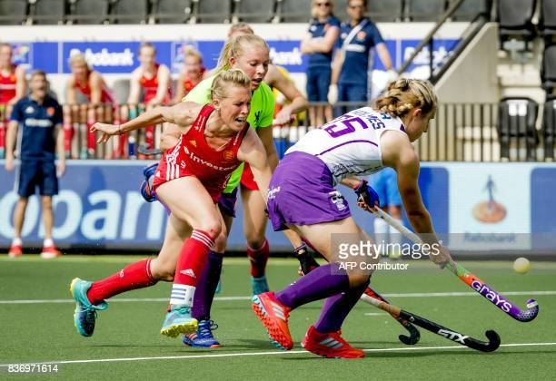 Alex Danson of England fights for the ball with Kareena Cuthbert and Kate Holmes of Scotland during the Women's Hockey Rabo EuroHockey Championships...