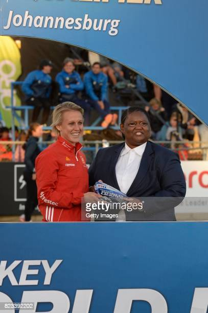 Alex Danson of England receives the trophy from Vice President of the South African Hockey Association Lwandile Simelane during day 9 of the FIH...