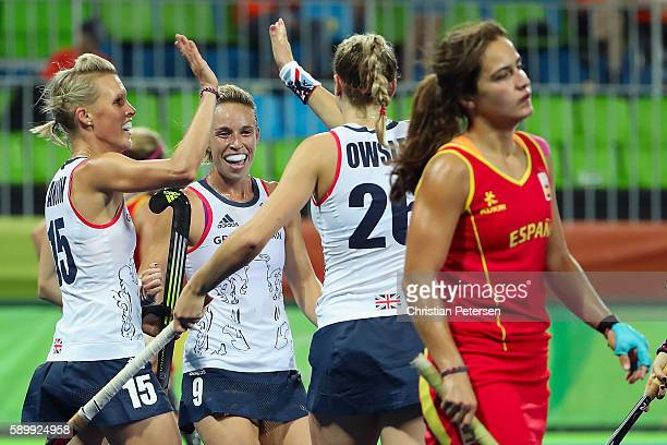 Alex Danson Susannah Townsend and Lily Owsley of Great Britain celebrate after Owsley scored a first half goal against Spain during the quarter final...