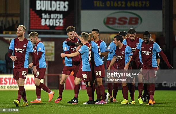Alex Davey of Scunthorpe is congratulated by teammates after scoring the opening goal during the FA Cup Third Round match between Scunthorpe United...