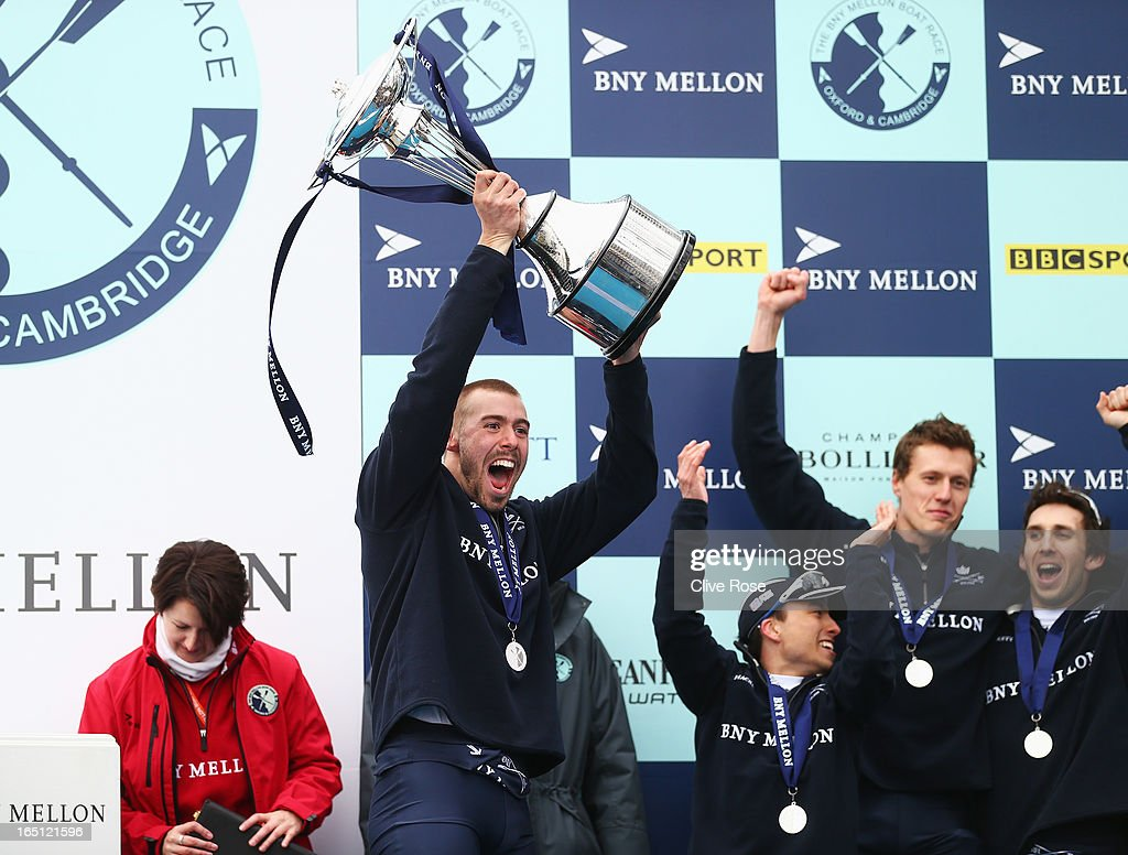 Alex Davidson, president of Oxford lifts the trophy after the BNY Mellon 159th Oxford versus Cambridge University Boat Race on The River Thames on March 31, 2013 in London, England.