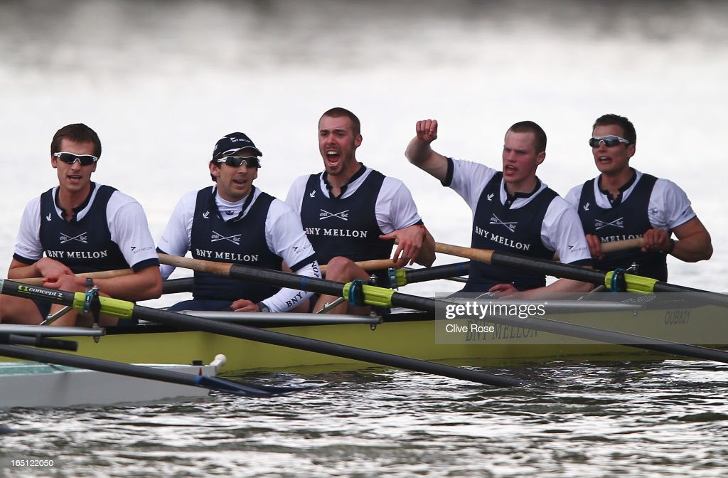 Alex Davidson (C), the Oxford president celebrates victory with team mates after the BNY Mellon 159th Oxford versus Cambridge University Boat Race on The River Thames on March 31, 2013 in London, England.