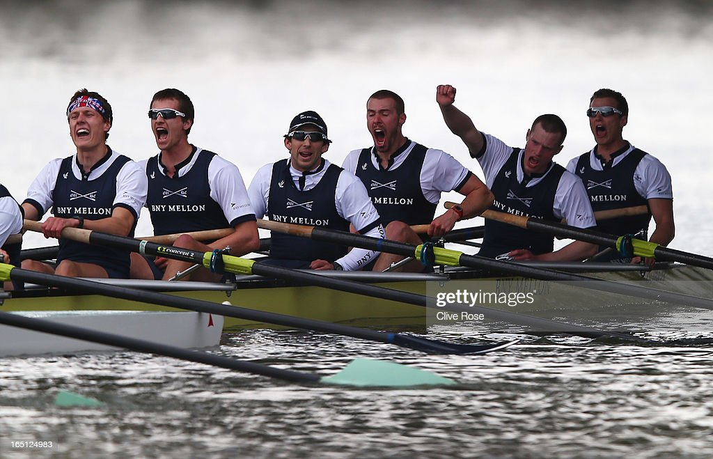 Alex Davidson (3rdR), the Oxford president celebrates victory with team mates after the BNY Mellon 159th Oxford versus Cambridge University Boat Race on The River Thames on March 31, 2013 in London, England.