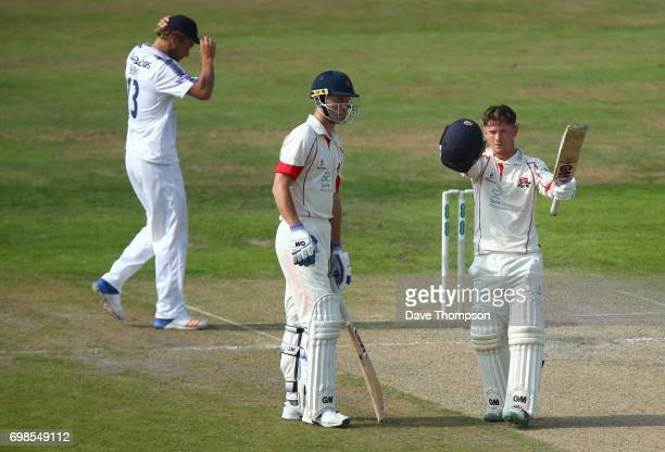 Alex Davies of Lancashire celebrates making his century alongside Dane Vilas during day two of the Specsavers County Championship game between...