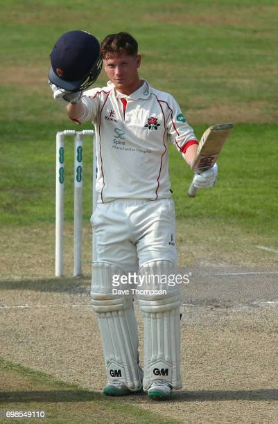 Alex Davies of Lancashire celebrates making his century during day two of the Specsavers County Championship game between Lancashire and Hampshire at...