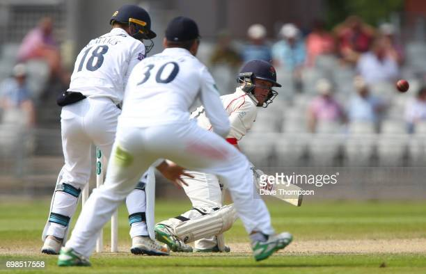 Alex Davies of Lancashire plays a reverse sweep shot during day two of the Specsavers County Championship game between Lancashire and Hampshire at...