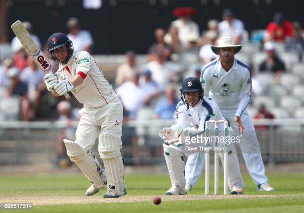 Alex Davies of Lancashire plays a shot during day two of the Specsavers County Championship game between Lancashire and Hampshire at Old Trafford on...