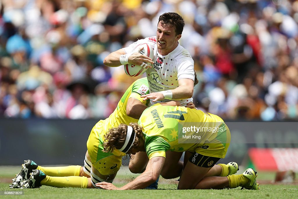 Alex Davis of England offloads the ball in a tackle during the 2016 Sydney Sevens Cup Quarter Final match between England and Australia at Allianz Stadium on February 7, 2016 in Sydney, Australia.