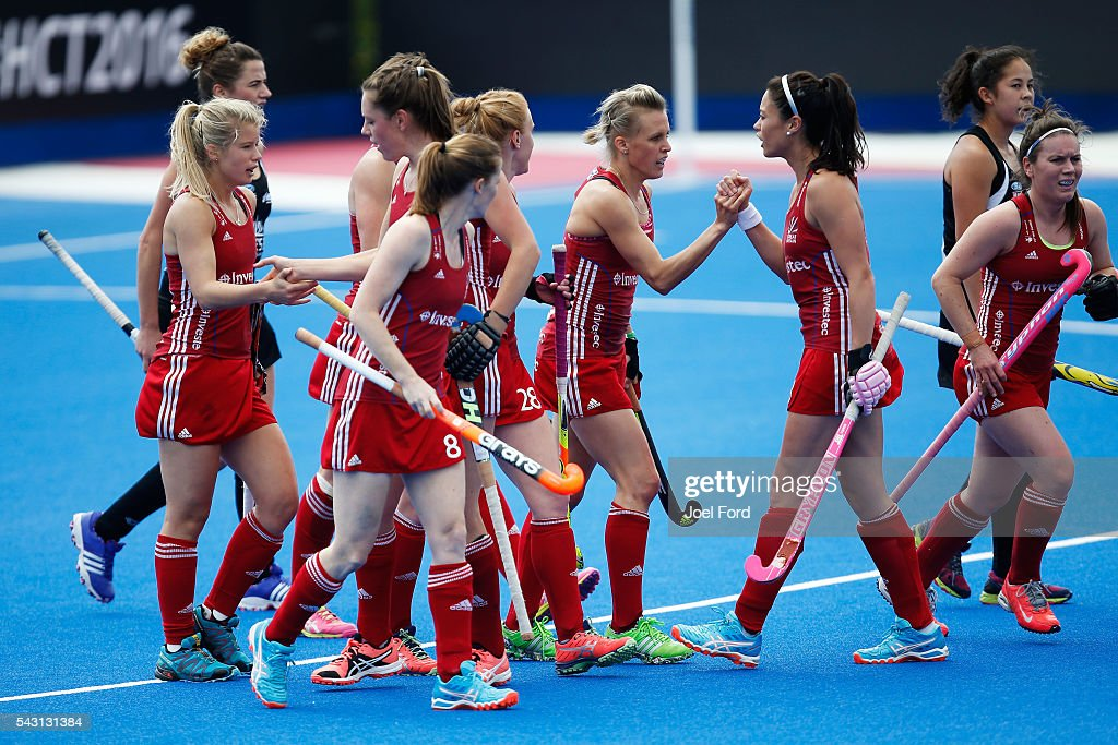 Alex Dawson (centre) of Great Britain is congratulated by teammates after scoring a goal during the FIH Women's Hockey Champions Trophy 2016 match between New Zealand and Great Britain at Queen Elizabeth Olympic Park on June 26, 2016 in London, England.
