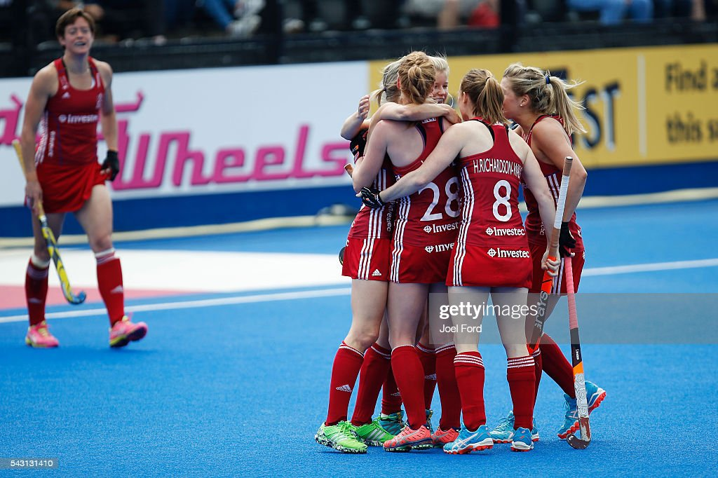 Alex Dawson of Great Britain is congratulated by teammates after scoring a goal during the FIH Women's Hockey Champions Trophy 2016 match between New Zealand and Great Britain at Queen Elizabeth Olympic Park on June 26, 2016 in London, England.