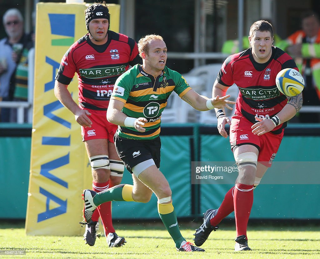 Alex Day of Northampton passes the ball during the pre season friendly match between Northampton Saints and Moseley at Franklin's Gardens on August 23, 2014 in Northampton, England.