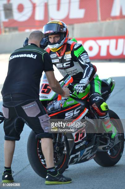 Alex De Angelis Kawasaki ZX10RR Pedercini Racing SCProject gets last minute adjustments on his bike before heading out to track at the SBK/MOTUL FIM...
