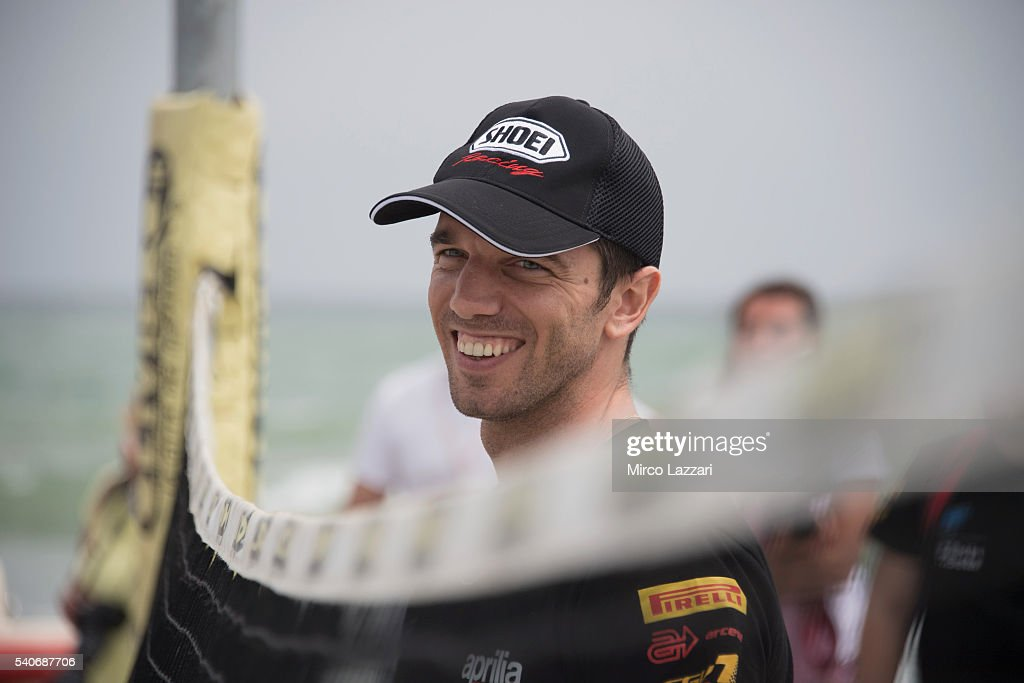 Alex De Angelis of Rep. San Marino and IodaRacing Team smiles during the pre-event on the beach in Misano Adriatico during the FIM Superbike World Championship - Preview at Misano World Circuit on June 16, 2016 in Misano Adriatico, Italy.