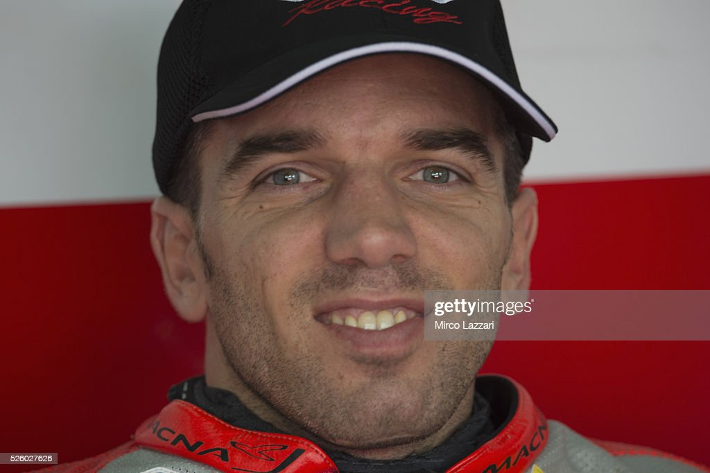 Alex De Angelis of Rep. San Marino and IodaRacing Team smiles in box during the World Superbikes - Practice at Enzo & Dino Ferrari Circuit on April 29, 2016 in Imola, Italy.