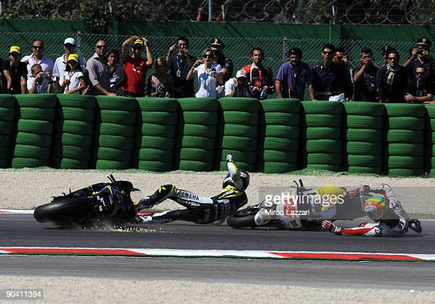 Alex De Angelis of San Carlo Honda Gresini and Colin Edwards of Monster Yamaha Tech 3 crash out during the MotoGP race during the MotoGP of San...