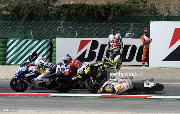 Alex De Angelis of San Carlo Honda Gresini Colin Edwards of Monster Yamaha Tech 3 and Nicky Hayden of Ducati Malboro crash out during the MotoGP race...