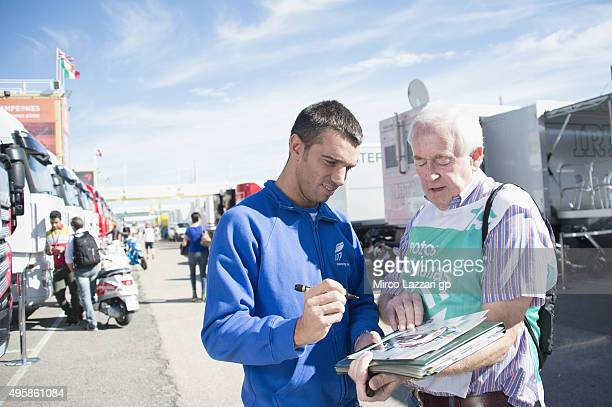 Alex De Angelis of San Marino and EMotion Iodaracing Team signs autographs for fans during the MotoGP of Valencia Previews at Ricardo Tormo Circuit...