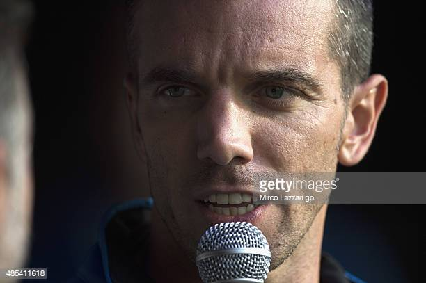 Alex De Angelis of San Marino and EMotion Iodaracing Team speaks during the 'charity auction for Day of Champions' during the MotoGp Of Great Britain...