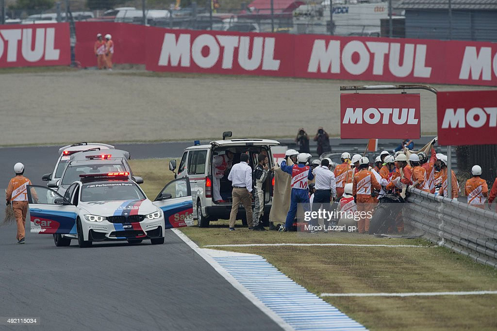 Alex De Angelis of San Marino and E-Motion Iodaracing Team with medical staff after crashed out during the qualifying practice during the MotoGP Of Japan - Qualifying at Twin Ring Motegi on October 10, 2015 in Motegi, Japan.