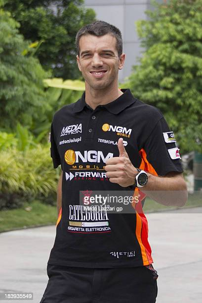 Alex De Angelis of San Marino and NGM Mobile Forward Racing walks in paddock during the MotoGP Of Malaysia Preview at Sepang Circuit on October 10...