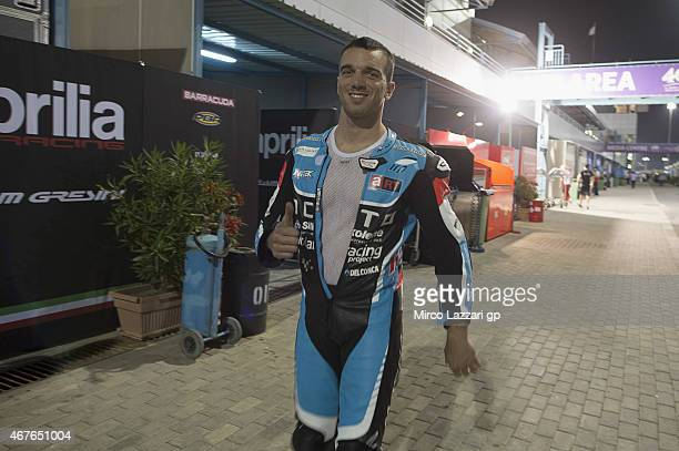 Alex De Angelis of San Marino and Octo Iodaracing Team greets in paddock during the MotoGp of Qatar Free Practice at Losail Circuit on March 26 2015...