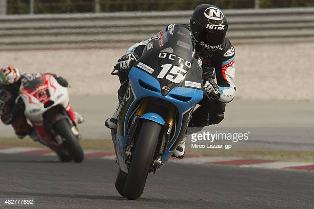 Alex De Angelis of San Marino and Octo Iodaracing Team heads down a straight during the MotoGP Tests in Sepang Day Two at Sepang Circuit on February...