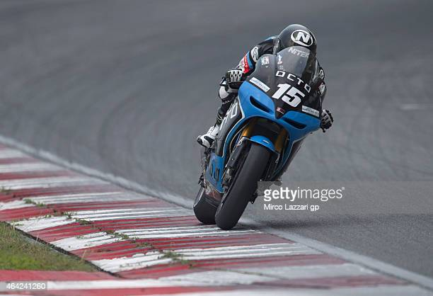 Alex De Angelis of San Marino and Octo Iodaracing Team heads down a straight during the MotoGP Tests in Sepang Day One at Sepang Circuit on February...