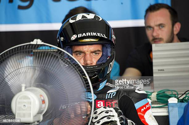 Alex De Angelis of San Marino and Octo Iodaracing Team looks on in the box during the MotoGP Tests in Sepang Day Three at Sepang Circuit on February...
