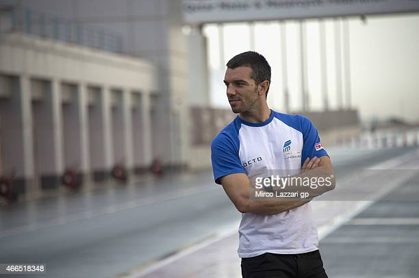 Alex De Angelis of San Marino and Octo Iodaracing Team looks on in pit during the MotoGP Tests in Qatar Day Three at Losail Circuit on March 16 2015...
