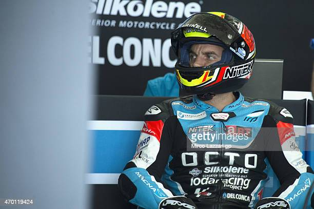 Alex De Angelis of San Marino and Octo Iodaracing Team looks on in box during the MotoGp of Argentina Free Practice at on April 17 2015 in Rio Hondo...