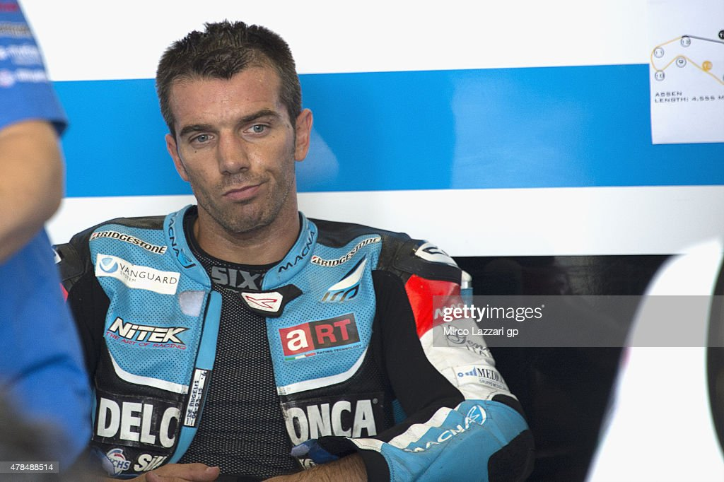 Alex De Angelis of San Marino and Octo Iodaracing Team looks on in box during the MotoGP Netherlands - Free Practice at on June 25, 2015 in Assen, Netherlands.