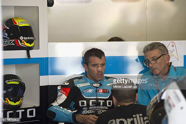 Alex De Angelis of San Marino and Octo Iodaracing Team speaks in box with mechanics during the MotoGp of Spain Free Practice at Circuito de Jerez on...