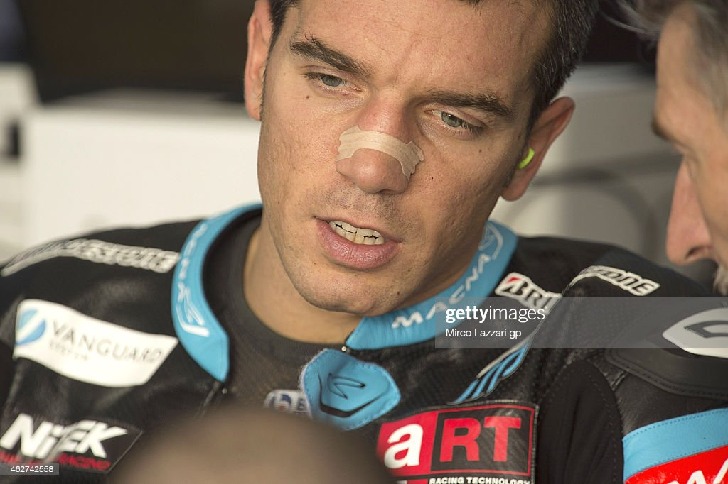 Alex De Angelis of San Marino and Octo Iodaracing Team speaks in the box during day one of the MotoGP tests at Sepang Circuit Sepang Circuit on February 4, 2015 in Kuala Lumpur, Malaysia.
