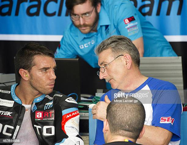 Alex De Angelis of San Marino and Octo Iodaracing Team speaks in the box with mechanics during the MotoGP Tests in Sepang Day Three at Sepang Circuit...
