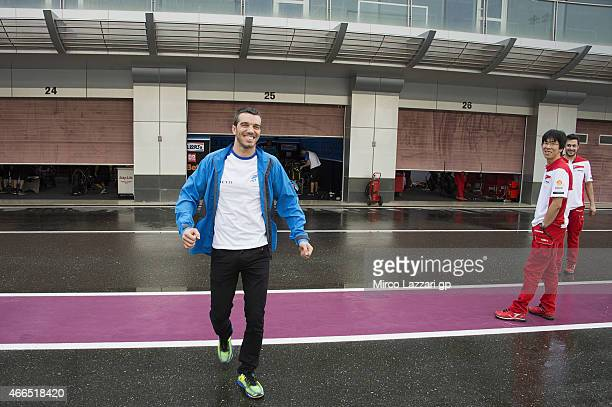 Alex De Angelis of San Marino and Octo Iodaracing Team walks in pit during the MotoGP Tests in Qatar Day Three at Losail Circuit on March 16 2015 in...