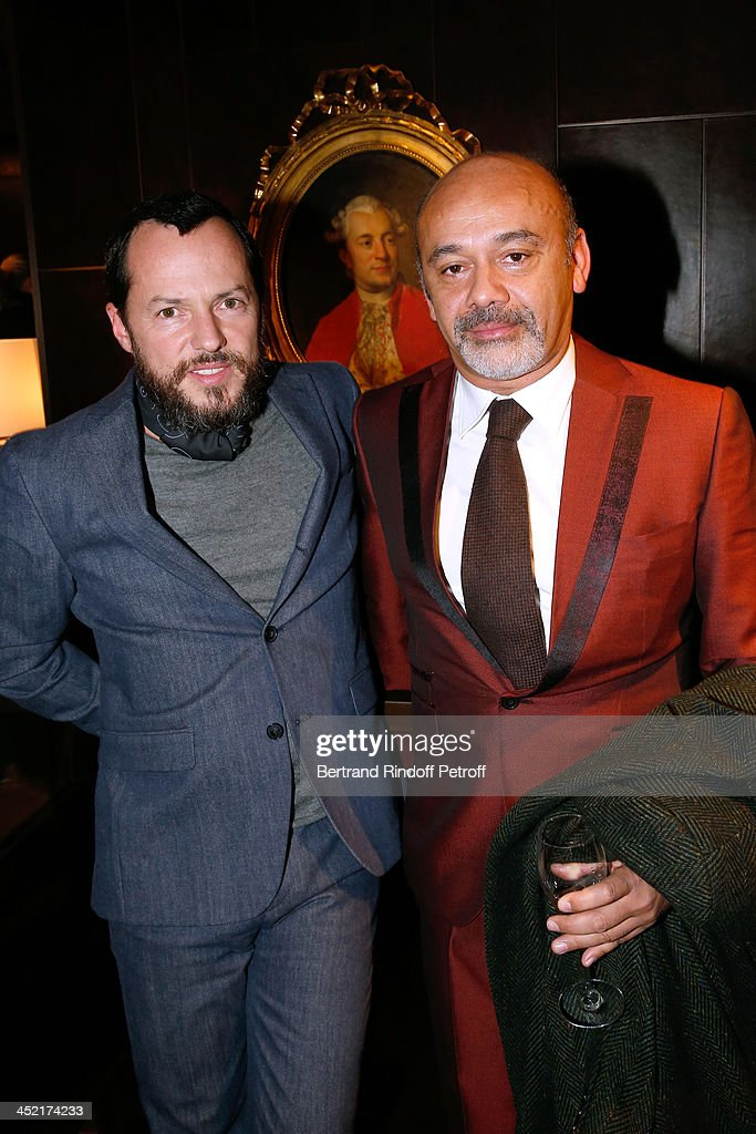 Alex de Betak and <a gi-track='captionPersonalityLinkClicked' href=/galleries/search?phrase=Christian+Louboutin+-+Fashion+Designer&family=editorial&specificpeople=4644509 ng-click='$event.stopPropagation()'>Christian Louboutin</a> attend Berluti Flagship Store Opening on November 26, 2013 in Paris, France.