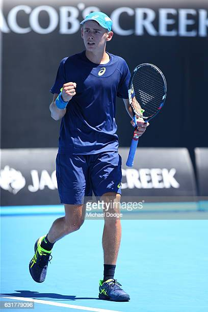 Alex De Minaur of Australia celebrates a point in his first round match against Gerald Melzer of Austria on day one of the 2017 Australian Open at...