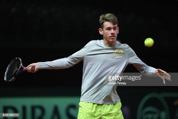 Alex De Minaur of Australia hits with Nick Kyrgios of Australia during day three of the Davis Cup World Group semi final match between Belgium and...