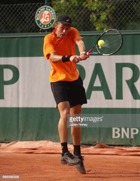 Alex De Minaur of Australia plays a backhand during the mens singles first round match against Robin Haas of the Netherlands on day one of the 2017...