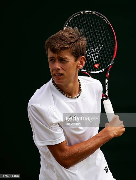 Alex De Minaur of Australia plays a backhand in his Boy's Singles First Round match against Reilly Opelka of the United States during day seven of...