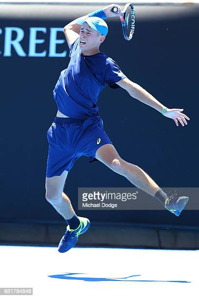 Alex De Minaur of Australia plays a forehand in his first round match against Gerald Melzer of Austria on day one of the 2017 Australian Open at...
