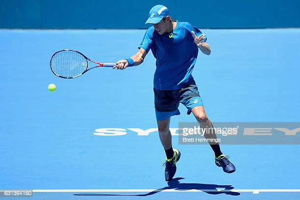 Alex De Minaur of Australia plays a forehand shot in his first round match against Benoit Paire of France during day three of the 2017 Sydney...