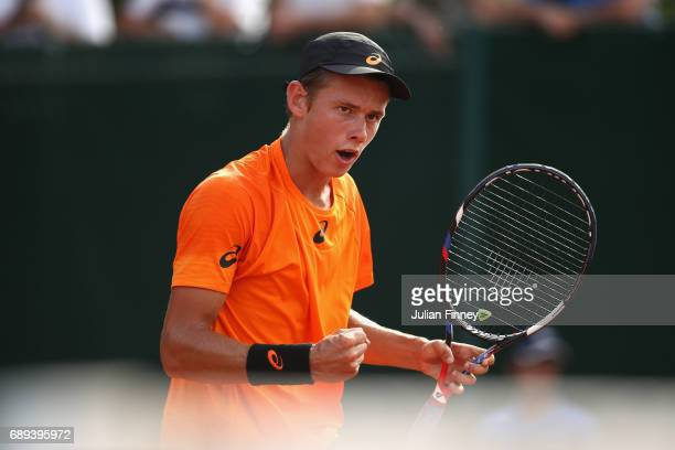 Alex De Minaur of Australia reacts during the mens singles first round match against Robin Haas of The Netherlands on day one of the 2017 French Open...
