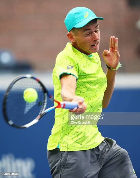 Alex de Minaur of Australia returns a shot to Dominic Thiem of Austria during their first round Men's Singles match on Day Two of the 2017 US Open at...