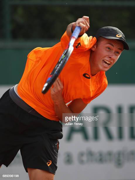 Alex De Minaur of Australia serves during the mens singles first round match against Robin Haas of the Netherlands on day one of the 2017 French Open...