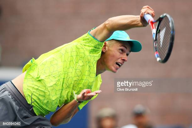 Alex de Minaur of Australia serves to Dominic Thiem of Austria during their first round Men's Singles match on Day Two of the 2017 US Open at the...