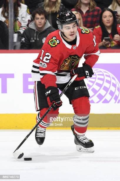 Alex DeBrincat of the Chicago Blackhawks controls the puck in the first period against the Anaheim Ducks at the United Center on November 27 2017 in...
